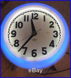 Electric neon clock company cleveland vintage neon clock original sign wall